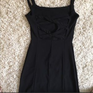 Strapping back fitted little black dress